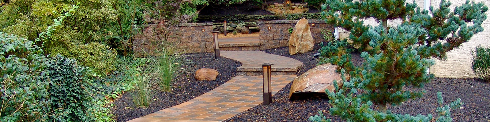 Stone pathway through landscaped yard